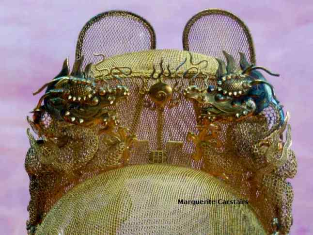 The thirteenth Tomb was opened and the treasures removed for display. This crown is made of solid gold with two dragons on either side