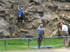 Climber controlled with rope and assistant